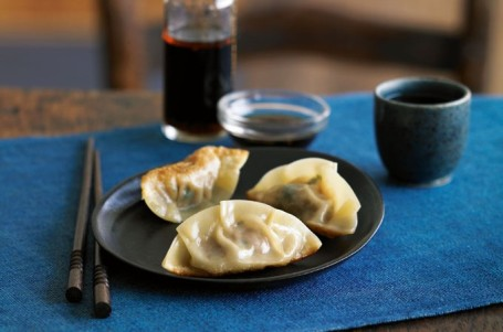 Simple, delicious potsticker dumplings, with ginger-soy dipping sauce, photographed by Maren Caruso for my Quick & Easy Chinese cookbook.